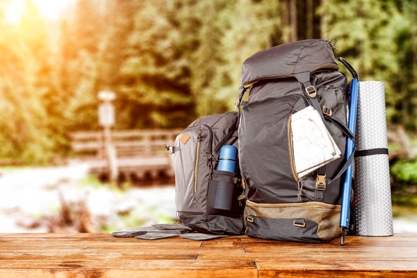 Travel backpack and river with forest