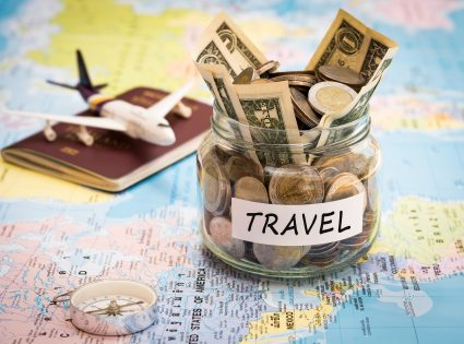 map with money jar for travel