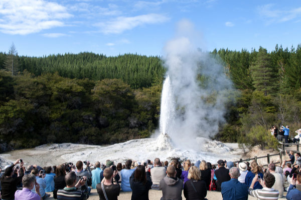 Tourists watching Erupting Lady Knox geysir in Wai-o-Tapu