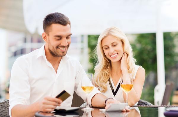 happy couple spending money on vacation