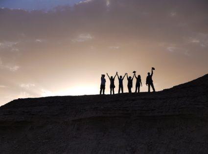 group traveling mongolian desert